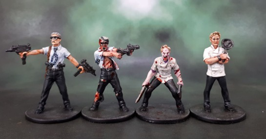 "Zombicide ""Jesse"" aka Gordon Ramsey, Zombicide ""Doug"" aka Michael Douglas as William Foster from Falling Down."